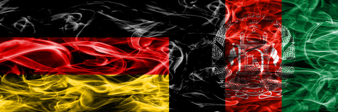 Germany vs Afghanistan smoke flags placed side by side. German and Afghanistan flag together