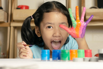 The little girl is showing painted color on hand