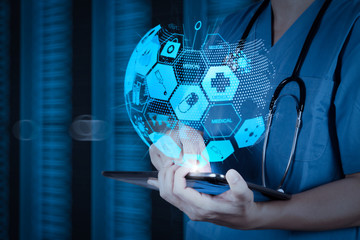 Doctor working on a digital tablet with digital background as concept