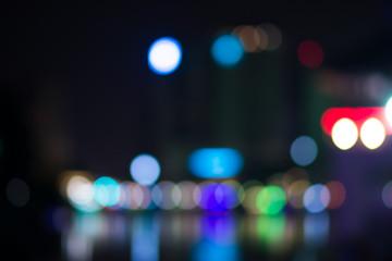 City, street, night defocused, light & blur bokeh. Colorful & dark background.
