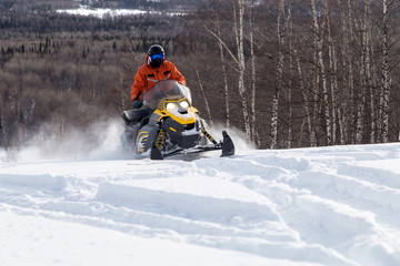 Athlete on a snowmobile