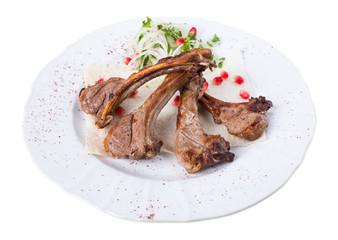 Delicious lamb racks on pita.