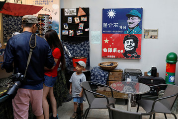 Pictures of former China's Chairman Mao Zedong and Taiwan's Nationalist leader Chiang Kai-shek are seen at a restaurant of a museum, ahead of the 60th anniversary of Second Taiwan Straits Crisis against China in Kinmen