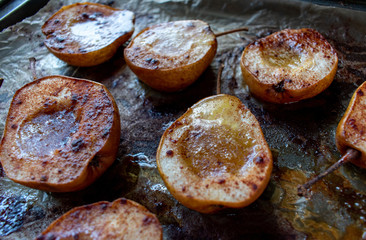 baked pears with maple syrup and cinnamon on wax paper