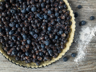 Unbaked blueberry tart flat lay