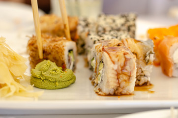 Sushi in hand restaurant in a restaurant seafood fresh roll