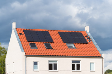 houses with solar panels on the roof