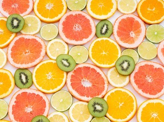 oranges ,grapefruit, and other fruits sliced  Wall mural