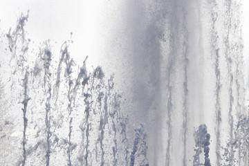 Fountain water streams dynamic motion. Wet spray summer waterfall.