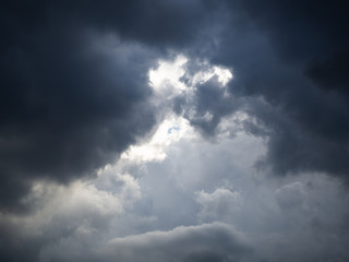 Dramatic sky and thick clouds and light beam.