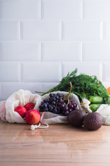 Fresh grocery produce in reusable cotton bags, zero waste concept