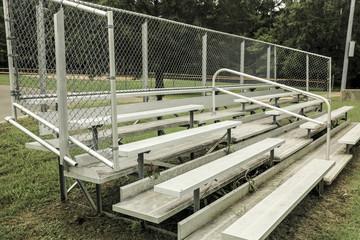 Empty Bleachers at Baseball Field