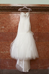 Bridal gown against granite wall