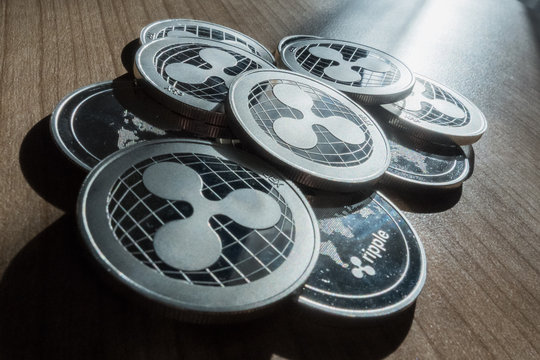 Ripple XRP crypto currency coins stack on table