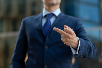 Business man in suit showing fuck sign and quit the job