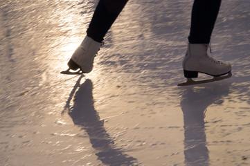 Ice skating on melting ice during sunset