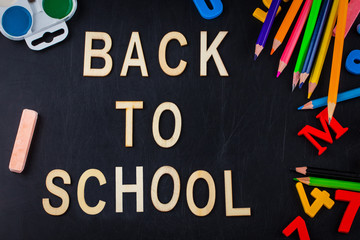 School supplies on blackboard background with copy space