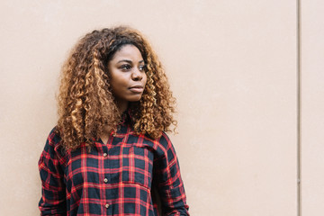 Portrait of young black woman looking away