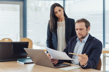 Two business colleagues working on a document
