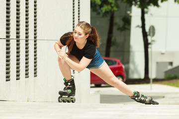 Young woman fast riding roller skates