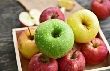 colorful of 3 Type of apple,Gala,Granny Smith,Golden Delicious in wooden box and wooden background.