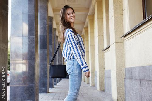 e558f2cb7db Street Style Outdoors Portrait of Beautiful Girl. Fashion Woman Smiling.  She wearing Print Shirt