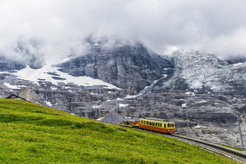 Swiss Alpine Train Heading into Station After Approaching Bad Weather
