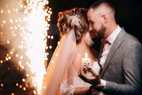 first wedding dance.Bridal couple dancing sorrounding by fireworks.