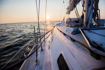 Sailing at sunset. A view from the yacht's deck to the bow. Baltic sea, Estonia