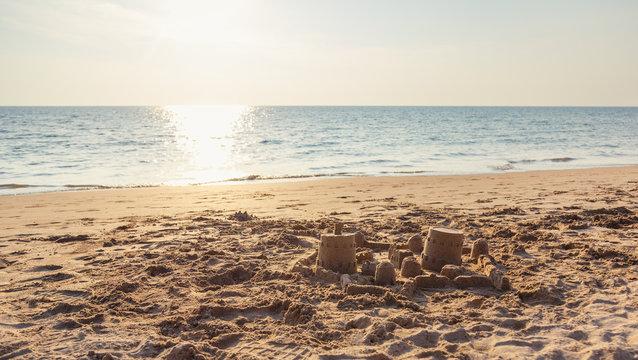 Sandcastle on the sea beach