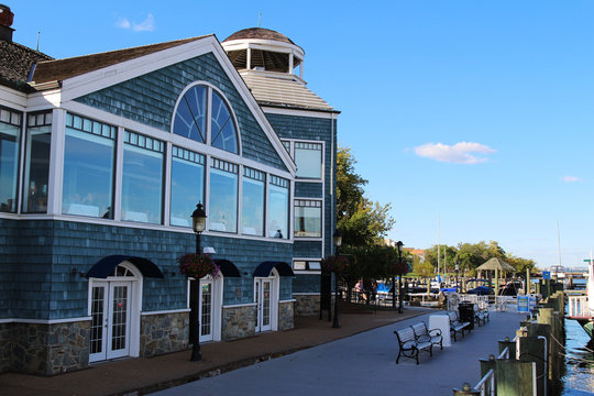 A historic building and boardwalk along the Potomac River waterfront, Old Town Alexandria, Virginia