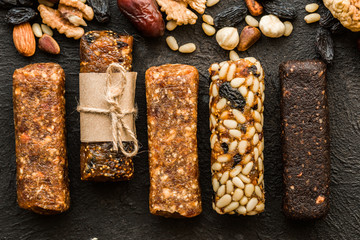 Homemade energy bars with figs Dried apricots, raisins, dates, figs, pine nuts, almonds, walnuts . healthy snack . copy space