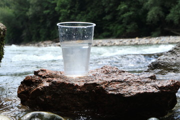 Picture of a plastic cup with water.