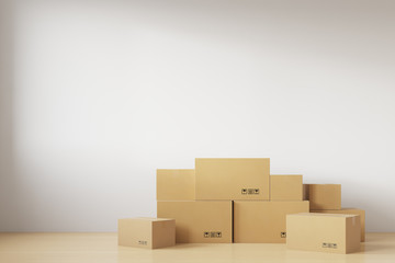 Relocation. A stack of cardboard boxes for moving standing near the white wall. 3d rendering