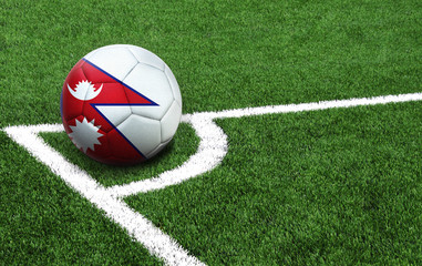soccer ball on a green field, flag of Nepal