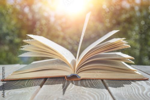 open book on the table sunset background concept learning reading
