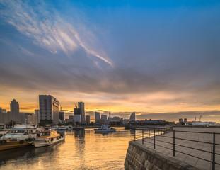 Panorama from Osanbashi Pier port where fishing boats are moored and in background Landmark Tower, Big Wheel, Pacifico Yokohama and  Red Brick Warehouse are illuminated in  Yokohama.