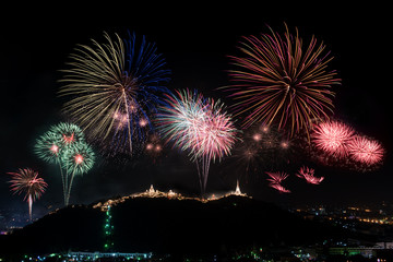 Beautiful colorful firework display on mountain dark sky for celebration night