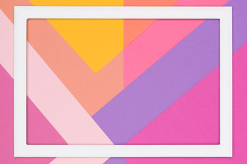 Abstract geometrical pastel pink and ultra violet paper flat lay background. Minimalism and geometry template with empty picture frame mock up.