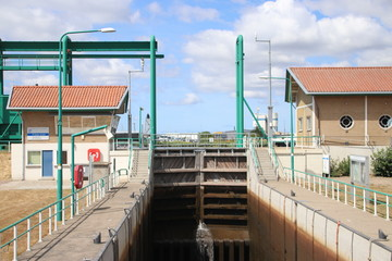 Sluice in the Lemstervaart canal to inner lake IJsselmeer in Lemmer. Difference between waterheights is 5.4 meters appr. 18 feet