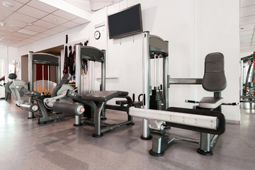 Gym interior with modern equipment. light modern room equipped with different fitness stations. concept of sport and healthy lifestyle