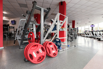 fitness hall interior with modern equipment. highly equipped light room. concept of sport and healthy lifestyle