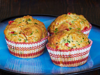 A plate with savory muffins with cheddar, spinach and red peppers