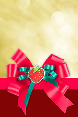 bright bokeh background and red bow