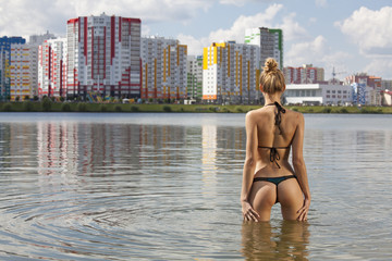 Woman in water on city beach