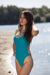 Woman in swimsuit on beach