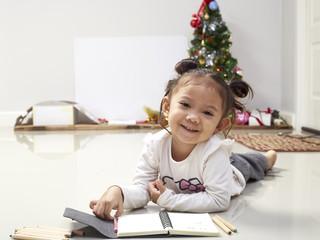 girl write wishes for Santa christmas