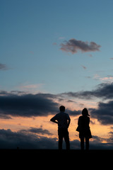 A couple standing in sunset