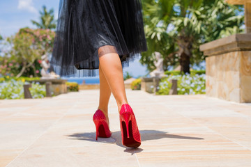 Woman walking in red high heels
