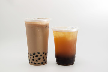 iced milk tea and bubble boba in the plastic glass on the white background